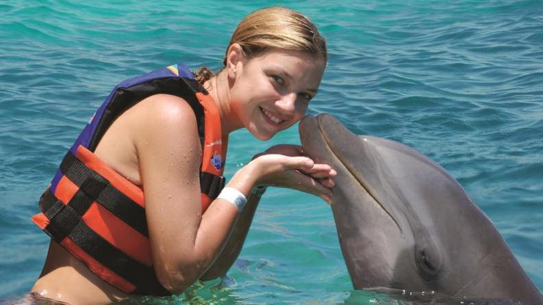 DOLPHIN LOVERS SWIM IN GRAND CAYMAN